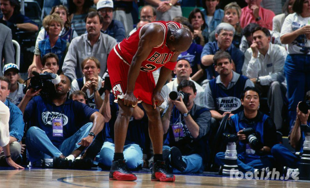 SALT LAKE CITY, UT - JUNE 13: Michael Jordan #23 of the Chicago Bulls rests during Game Five of the 1997 NBA Finals played against the Utah Jazz on June 11, 1997 at the Delta Center in Salt Lake City, Utah. The Chicago Bulls defeated the Utah Jazz 90-88. NOTE TO USER: User expressly acknowledges and agrees that, by downloading and or using this photograph, User is consenting to the terms and conditions of the Getty Images License Agreement. Mandatory Copyright Notice: Copyright 1997 NBAE (Photo by Nathaniel S. Butler/NBAE via Getty Images)